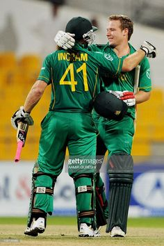 South African cricketers Colin Ingram and David Miller (R) celebrate after beating Pakistan in their first Twenty20 match at the Abu Dhabi Cricket Stadium in the Emirati capital on October 26, 2010. South Africa beat Pakistan by six wickets in the first of two Twenty20 internationals played in the United Arab Emirates.