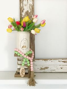 How to style wood bead garlands. - The Pickled Rose Wood Bead Garland, Tassel Garland, Tassels, Garlands, Easter Projects, Wooden Beads, Paper Flowers, Wood Projects, Ladder Decor