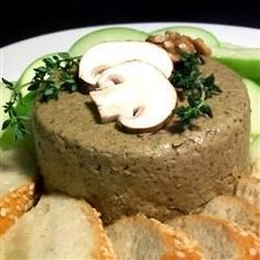 Shiitake, crimini, and portobello mushrooms are cooked in butter and garlic, and then pureed with walnuts to make this delicious pate.