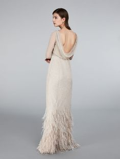 Max Mara 2018 / GALATEA / powder: Tulle, sequin and feather dress // Couture dress in powder-pink tulle embellished by all-over bead and sequin embroidery with soft, draped neckline at the back. The siren shape is emphasised by the dégradé feather motif that enhances the hem. Matching slip in the same colour. Small button fastening at the side.