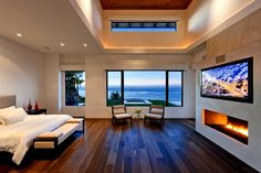 Love this room!! From the big bed, to the hardwood floor, to the gorgeous fireplace to the stunning view!!