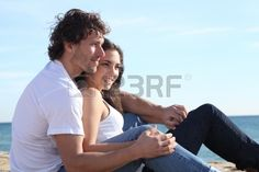 Man and woman couple flirting in the beach Stock Photo