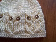 """This listing is for an Instant Download CROCHET PATTERN ONLY, and not the actual hat shown.    It's a Hoot!,, A beanie style hat done in beautiful cables to create an owl pattern all around the brim. The """"owls"""" eyes are buttons which are attached during the actual crochet work and not sewn after. So no sewing on later!!! Standard 5/8 Inch buttons were used, but pony beads may be used as well.    Stylish and classy for the adults and yet very cute and fun for the kids too!    Pattern is w..."""