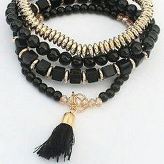 BLACK AND GOLD TASSEL BRACELET Multiple bracelets in black and gold. Very elegant Boutique  Jewelry Bracelets