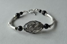 Black Foil Lined Faceted Bead Bracelet with Silver Plated Bar and Toggle Clasp £7.00