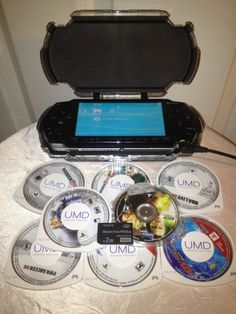 Sony PSP-1001 with 8 games, 2 GB Memory Stick Pro Duo, case & charger bundle