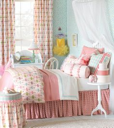 Matilda Collection from Eastern AccentsGet a little girly with Matilda. This ballet-inspired kid's bed is everything a little girl could wish for! Light pinks, purples, and apple greens mix with pretty appliqués of glitter and roses so your princess can feel like the belle of the ball. Personalize her bedroom with a silver hand-painted monogram pillow to make it extra-special.
