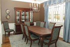 Sarah's dining room is simple yet opulent with a rich wood dining set and a tasteful use of moon mist and chocolate brown.