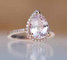 Break from tradition with a peach-champagne sapphire ring.