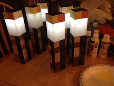 Solar powered Minecraft torches I made for my sons birthday, all dollar store materials