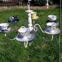 8cb81fb146094 vintage Upcycled chandelie and tea cupsr into birdfeeder candles.