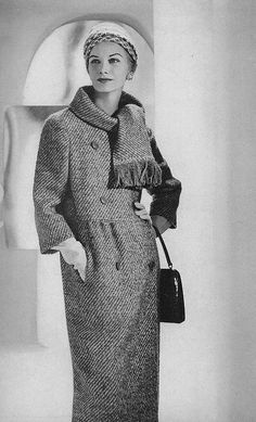 February Vogue 1959    Wearing a double breasted curry and white wool tweed coat by Jablow. Photographed by Horst P Horst.