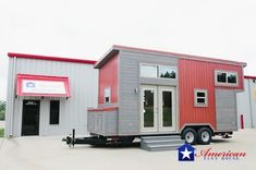 The Houston: an eye-catching 28' tiny house on wheels with a cozy 224 sq ft rustic interior.