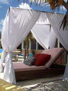 Outdoor lounging poolside ...canopy instead of umbrella