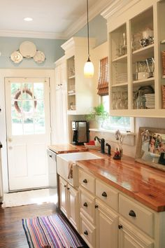 Wood Counters Add Warmth to a Clean White Kitchen