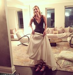 Ivanka shared a picture  of her daughter's legs poking out from underneath her gown. 'Eye Spy with My Little Eye...Arabella! #stowaway,' she captioned the photo