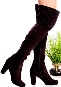Every girl needs a great pair of black over the knee boots, and these are perfect! These thigh high boots feature a suede material,side zipper,chunky high heel.Great for any occasion.