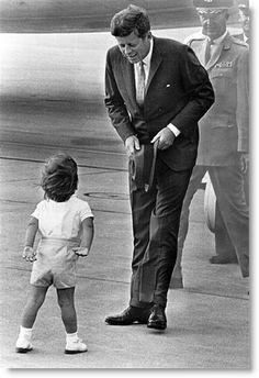 John-John greets his father on an airport runway
