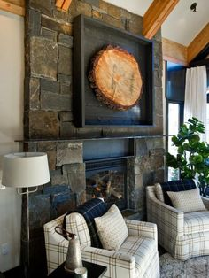 Veneered fieldstone, in reddish-brown and gray hues, clads the fireplace surround as well as the base of the adjacent patio. A piece of hot-rolled steel stands in as a mantel.