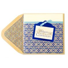 Begin the celebrations by sharing with loved ones a special Chanukah card embellished with specialty foil, light blue gems, and ribbon. This elegant pattern card includes a distinctive die-cut plaque enhanced with beautiful foil lettering and flourishes.