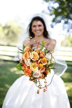 Enchanted Florist Bride with Orange Bouquet