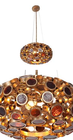 You're looking for extraordinary, and here it is: the Odyssey Donut Pendant. You'll salivate over the rich hues found in these welded rings of hand-forged steel, many of which house disc-shaped pieces ...  Find the Odyssey Donut Pendant in Kolorado, as seen in the Chandeliers Collection at http://dotandbo.com/category/lighting/chandeliers-and-pendants/chandeliers?utm_source=pinterest&utm_medium=organic&db_sku=121290