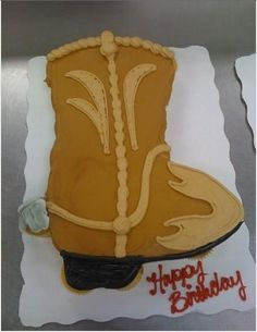 Cowboy Boot Cupcake Cake - 24 Cupcakes: Buttercream Icing, roughly in the Shape of a Cowboy Boot...kinda hard to do on cupcakes...