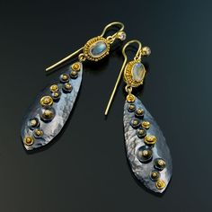 Elizabeth Gaultieri - granulated 22kt gold sterling silver moonstone. Interesting, I love the hammered shapes and metal mix