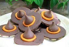 Witch Hat Cookies! Cookie Ingredients Are Keebler Fudge Stripe Cookies (turned Upside Down), Hershey Kisses Attached With Orange Wilton Tube Icing. Soooo Easy!