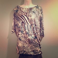 Animal Print Sassy Top   HP - Office Essentials Party 09/29/14  Rule Breaking Style Party 04/07/15  Worn 1x | Great Condition | Batwing Style | Bandeau Bottom | Runs Big | Fits L or XL | Dressy Top Feel | Lightweight | Black, White, Grey, & Turquoise Colors | Zebra & Cheetah Animal Print Designs | Perfect to Dress Up or Down |  Trades | Feel Free To Ask Questions | More  Upon Request | Bundles Are Welcomed ❤️| Poppi Tops Tunics
