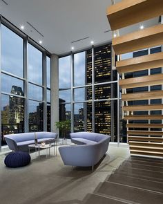 Glittering view of downtown Montreal and Stock Exchange Tower from the spacious penthouse living room Dazzling View of Cityscape: Minimal Penthouse Brings Downtown Montreal Indoors