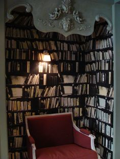 A bookshelf in the lobby of the Hotel du Petit Moulin in Paris.    http://www.paris-hotel-petitmoulin.com/index.html