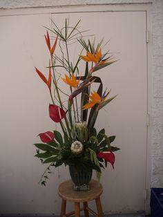 Red , orange , green flower arrangement for wedding and event.