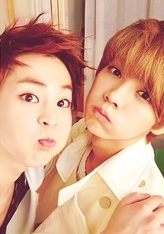 Luhan's face is cute... but nobody's cheeks are as pinchable as Baozi's! || XiuHan :3