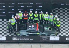 Aerial photo of the team surrounding the £1 million racing car
