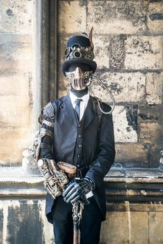 Steampunk Mystery Man in Black (article includes halloween costume tip involving second skin suits) - For costume tutorials, clothing guide, fashion inspiration photo gallery, calendar of Steampunk events, & more, visit SteampunkFashionGuide.com