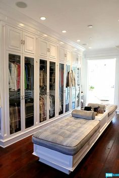 Master closet.  Wide planked wood floors and custom made benches.