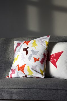 Cotton pillow with our own Origami pattern. Comes in one size, 50x50 cm with either patterned back and front or hand printed pink bird and black back.