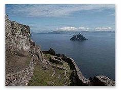 On a clear day, from Valentia Island in the northwest part of the Ring of Kerry, at the Iveragh Peninsula, you can see two conical rocks pointing toward th