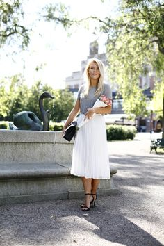 Linda Juhola in white pleated skirt from Asos, grey t-shirt by Bik Bok, Chanel bag and NLY Trend black shoes