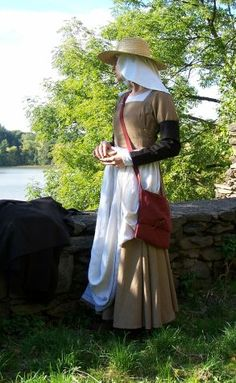 Brown peasant     Dress for working woman hand sewed form natural fabrics (15th century) consists of linen smock, brown dress, linen apron, woolen removable sleeves. Head is covered by linen veil and straw hat.