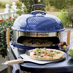 """Turn your charcoal grill into a wood-burning pizza oven with this clever kit. Pizza frame with thermometer, pan and baking stone lets you amp up the fiery heat for the best results on an 18.5"""" or 22.5"""" kettle grill. Pizza peel is there to help slide pies on and off the grill. Pizzeria-style pies bake in less than 8 minutes to the perfect crispness on the included professional-quality pizza stone."""