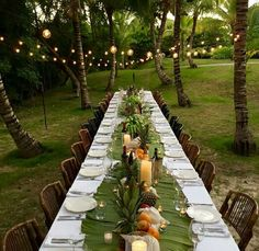 What an elegant and inexpensive way to dress a party table. Pluck some palms from the yard, accent with fruit and candles.
