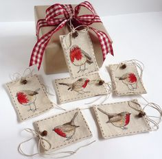 cross stitched robin gift tags.