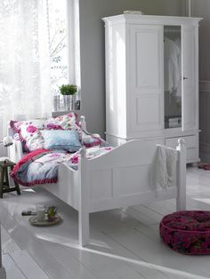 Gray walls, white armor, bed and floors, pop of color pink and light blue for this bedroom, c.a.p.
