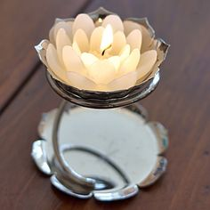 White Lotus Candle in stainless steel Lotus Candleholder. Use as centerpieces or for ceremony.