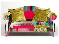 Love the look of mixed fabric upholstery... maybe not so bright, however.