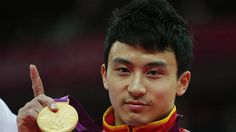 China's Feng Zhe holds his gold medal in the men's gymnastics parallel bars victory ceremony in the North Greenwich Arena during the London 2012 Olympic Games (Reuters)