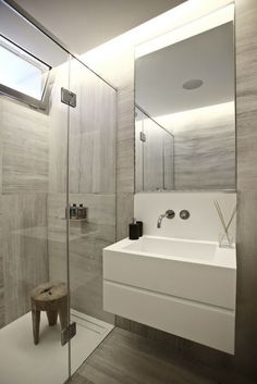 Bold Cosmopolitan House In Instanbul White modern sink with frameless mirror and faux wood tile #bathroom