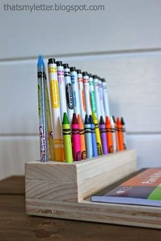 A DIY tutorial to make a crayon holder. Build this simple yet functional crayon holder for anyone who loves to color. A super easy gift idea. #freeplans